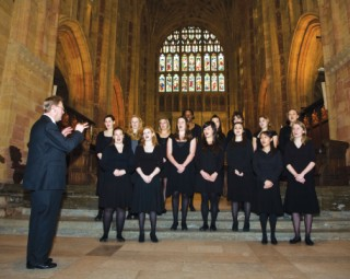 John Jenkins, the Director of Music, conducts the Madrigal Society in Sherborne Abbey