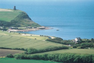 Kimmeridge Bay, with the recently re-positioned Clavell Tower on the left