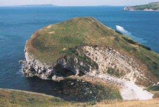 The mass of Worbarrow Tout dwarfs Pondfield Cove. Note the anti-tank Dragon's Teeth on the extreme right.