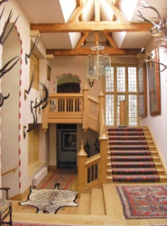 The staircase and hall created from an outside courtyard which had effectively cut off a large part of the house