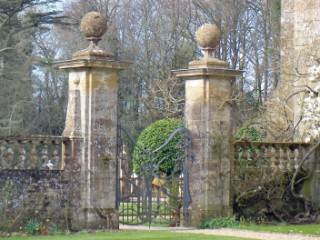 The imposing and unusual gate at the front of the house.