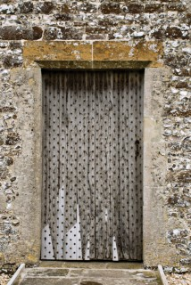 The nail-studded west door, St Andrews Church, Winterborne Tomson