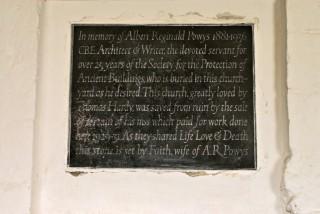A commemorative plaque to AR Powys , St Andrews Church, Winterborne Tomson