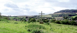 The Martyrs' Cross with the village behind (left), and its commemorative plaque - Chideock.Dorset