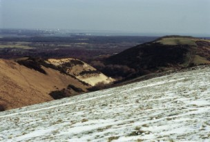 Snow lingers on the north-facing slope of Ridgeway Hill near East Creech