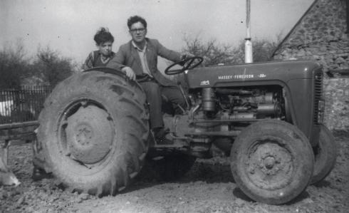 Les (and a nephew) with his first tractor, which he bought in 1960