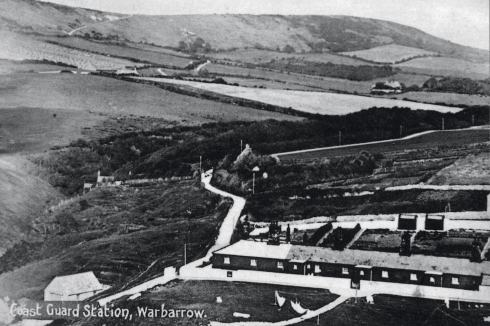 Worbarrow Coastguard Station, showing its black-painted range of single storey buildings. Although this view was taken in 1905, it would have been instantly recognisable to George Grebbell, Phoebe's father.