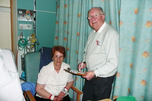 Presenter John Savage collects a request from Ms Ellen Hughes of Parkstone, in the short-stay ward of the Eye Unit