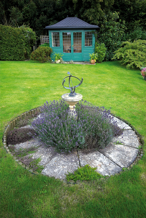 Lavender surrounds a small sundial