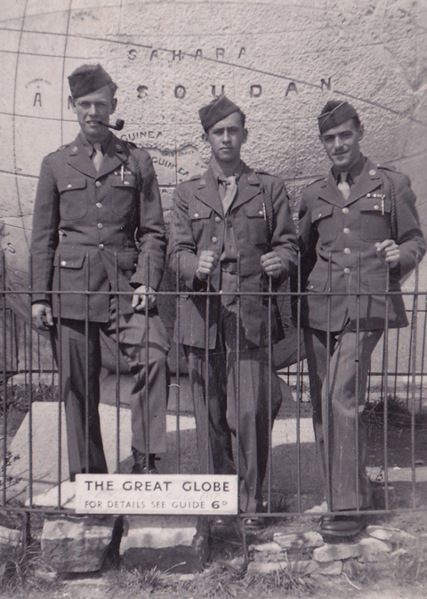 The arrival of American troops had a major effect on Swanage. Here three GIs in 'walking out' uniforms have somehow got inside the railings round the Giant Globe.