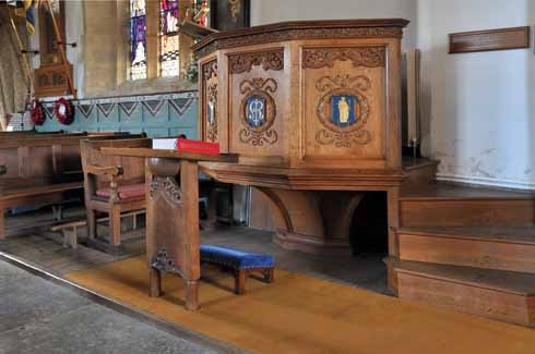 Inside the 15th century church, there is a 14th century Font with its 12th century base, as well as this a 20th century wooden pulpit, which makes for a historically interesting, if not always aesthetically harmonious, mix of styles.