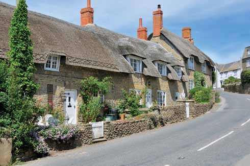 According to Treves: 'The village is exceedingly pretty, possessing many delightful old houses and cottages with thatched roofs.' This once accurate description is today less appropriate thanks to some undistinguished new building, and to the number of static caravans in the area.