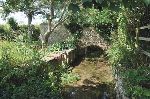 Reflecting the industrial past of the village, the mill stream is but one of a number of watercourses running through Burton, which originally takes its name from the River Bride (it was known as Bridetone in Norman times), while Bradstock comes from the Abbey of Bradenstoke in Wiltshire which held the manor from the 13th century