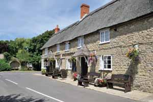 Burton Bradstock still keeps the spirit of a village, with its two pubs, post office and shop and school. The reason for the pub to share its emblem with the Worshipful Company of Farriers is lost in the mists of time.