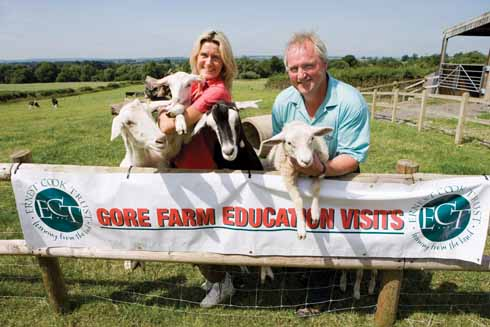 Tenant farmers Stuart and Tessa Casely with goats on Gore Farm on the Ernest Cook's Trent Estate