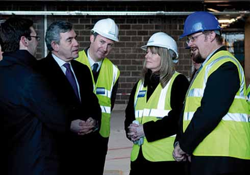 Prime Minister Gordon Brown  is shown progress on the building of the new Museum of Liverpool by Jon Murden (in the blue helmet)