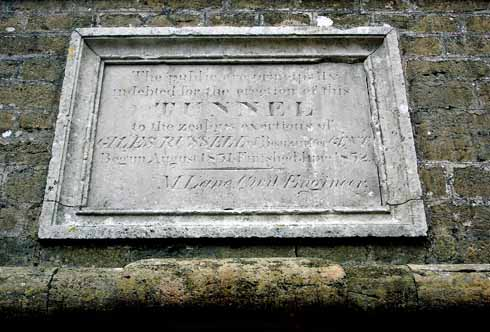 This close-up of the plaque that can be seen in the picture on page 00 was taken from scaffolding erected for the 2009 repairs. It pays proper tribute to the 'zealous exertions' of Giles Russell.