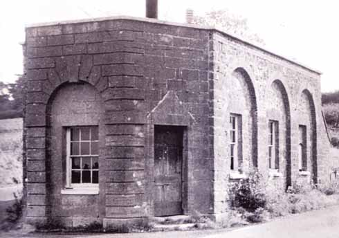 This tollhouse was erected on the north side soon after the tunnel was completed. After the tollgates were removed in 1881, this house was occupied by the tunnel's lamplighter. It was demolished when the road was widened.