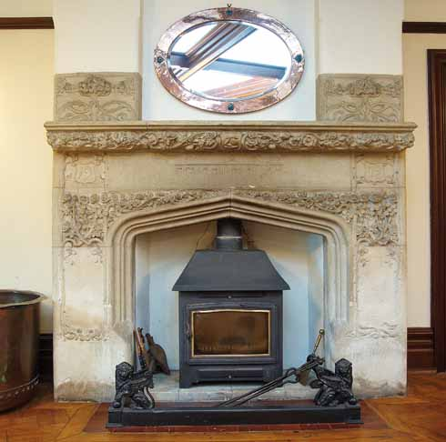 The striking fireplace in the main hall has ornate decoration, a Sanskrit inscription and the date '1902'