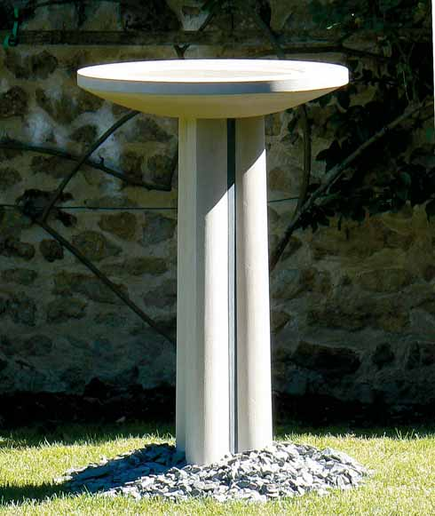 An elegant birdbath of Portland stone and Cumbrian green slate