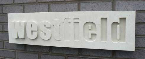 This sign for Westfield Technology College, Weymouth, is Portland stone and is an example of raised and sunken lettering