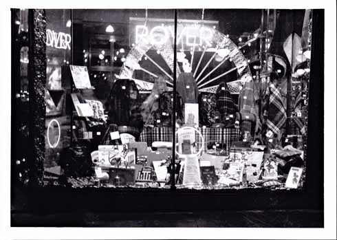 Tilley's Motor Showroom on South Street in the 1930s. The notice in the middle says 'Christmas gifts'. These included rugs at the back and motoring things in the foreground.