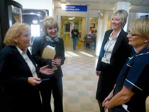 Jane Stichbury, second left, on one of her walkabouts with, left to right, Joan Pounds (Chair of League of Friends), Alison Ashmore (General Manager of Outpatient Services) and Carol Penfold (Outpatient Services Clinical Leader)