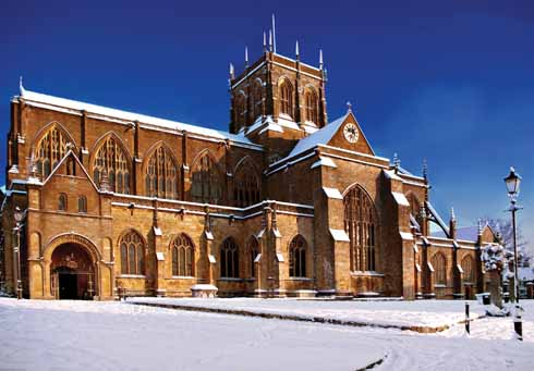 A suitably snow-bedecked Sherborne Abbey at Christmas time