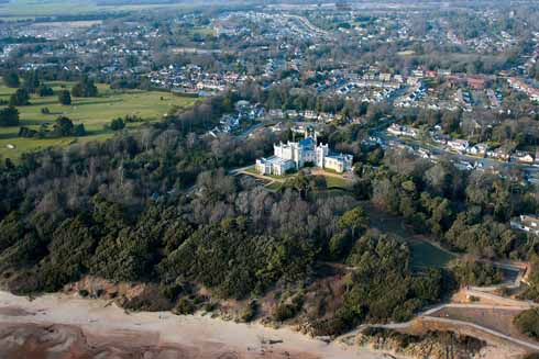 A more distant view of Highcliffe showing its woodland, beach proximity and the more urban hinterland