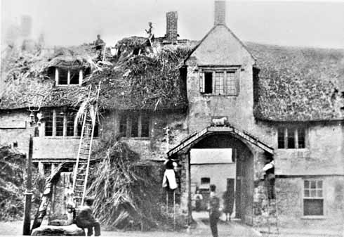 Demolition starts in September 1898 – pulling off the thatch and taking down the sign over the entrance archway. The thatch was five feet thick and consisted of at least seven layers.