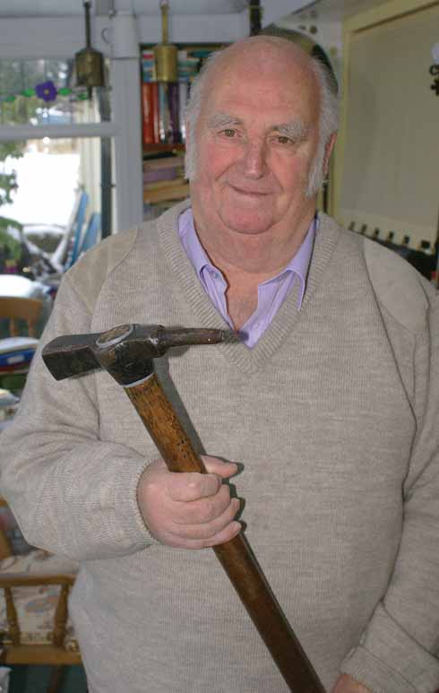 Larry Skeats holding a knock hammer – the precursor of today's abattoir stun-guns