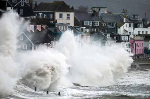 Storms often batter our coastline during the winter months. A strong south or southwesterly wind can bring huge rolling waves crashing ashore, as shown in this image of Lyme Regis.