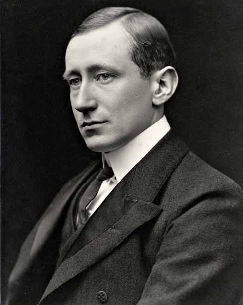 Black and white photographic studio portrait of Marconi, taken shortly after his arrival in England