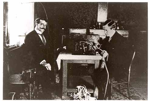 Marconi and George Kemp with some of Marconi's early equipment