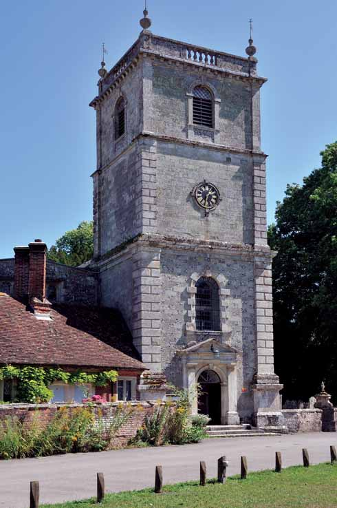 The church tower dates to 1732 and was probably designed by the Bastard brothers of Blandford; it is attached to the earlier almshouses, which were built in 1624