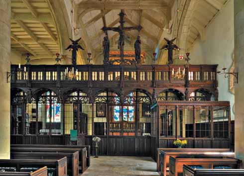 The delicate oak screen, adorned with life-sized figures, separates the nave and chancel; the Shaftesbury family pew is attached on the nave side
