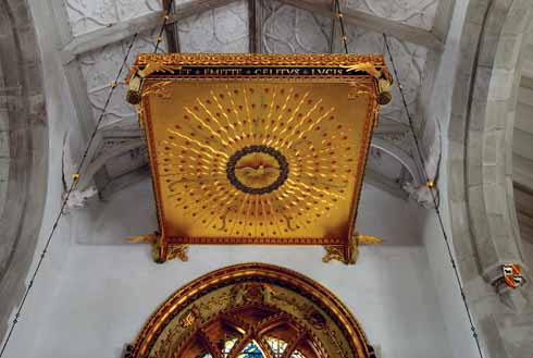 High above the altar is a spectacular, heavily-gilded tester, complete with a holy dove and tongues of fire