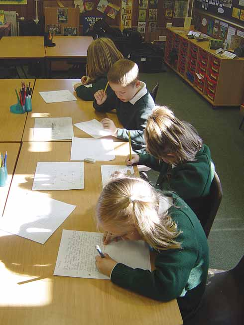 KS1 pupils at Writing Club, working on their own compositions.