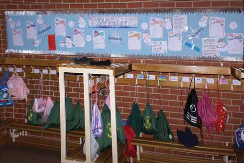 Every usable inch of wall space is used to reinforce the formal classroom lessons. Here poetry, pupils' written work and related information all subliminally inform as the children take off and put on their coats.