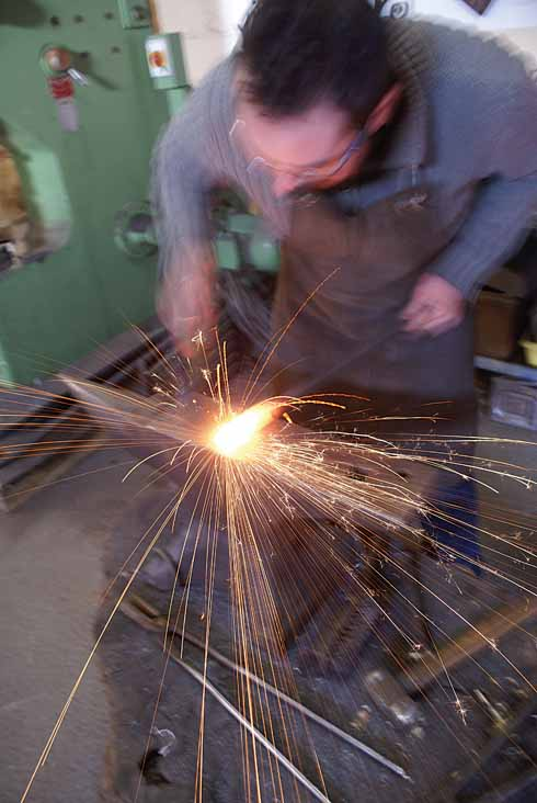 Adam Greenwell starts the process of creating a ram's-head fire companion set from a square-section piece of mild steel