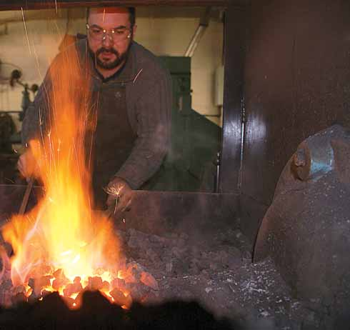 Before any of the five techniques of forging – drawing, shrinking, bending, upsetting, and punching – can be carried out, the metal needs to be heated to the correct temperature; this is determined by eye and experience