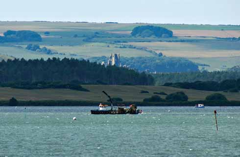 The 'eco-harvester' above the shellfish beds in Poole Harbour, with Corfe Castle beyond