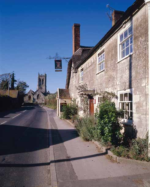 Marnhull was Hardy's Marlott, where, in the Pure Drop Inn 'there's a pretty brew in tap'. Little altered since Hardy's time, and with a 'Pure Drop' bar, the Crown Inn is the 'Pure Drop' of Tess, and figures many times in the book.