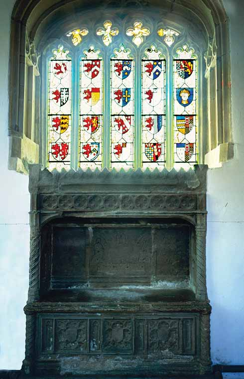The real-life Turberville family's coat of arms in Bere Regis church, with the Purbeck marble tomb immediately below it. According to Tess's father, John Durbeyfield: 'Under the church of that there parish lie my ancestors – hundreds of 'em – in coats of mail and jewels.'