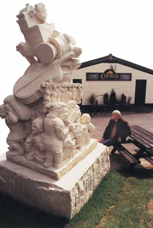 Ward Bullock alongside the statue he commissioned to celebrate the markets of Wareham