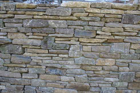 The back of the castle lay on a fault-line and had to be strapped and secured. The gabions with this was done were then faced in stone.