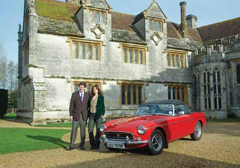 Patrick and Andrea Cooke with the classic MG which was driven by Michael Caine in 'Sleuth', filmed at Athelhampton