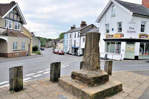 The old market cross stands at the junction of Dorchester Road and Church Road. The five-foot-high cross was moved from its original position in 1998 to protect it from likely traffic damage. From a distance, there is little to discern, but closer to, the west face of has much-weathered figures standing on a corbelled projection. It dates probably from the 15th century.