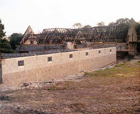 North Barn's roof timbers revealed, with the controversial building work in the foreground