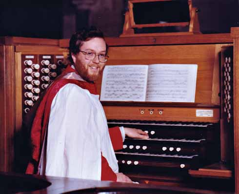 Michael at the organ of Wimborne Minster, where he was Assistant Organist for seven years